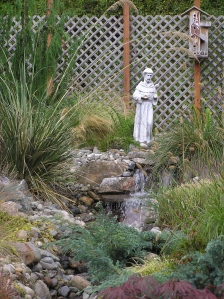 St Francis & waterfall create sacred space